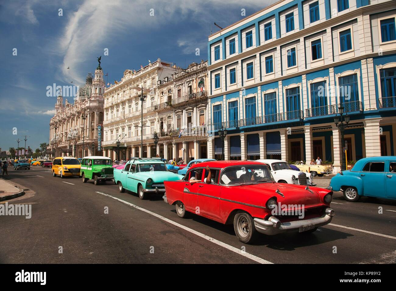 Colorful old American cars used as taxi in front of the Hotel Telegrafo and Hotel Inglaterra in Central Havana, - Stock Image