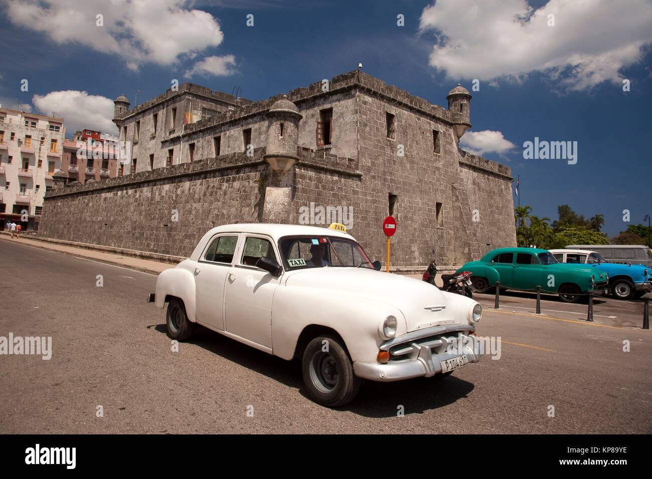 Old American cars used as taxi in front of the castle-fortress used ...