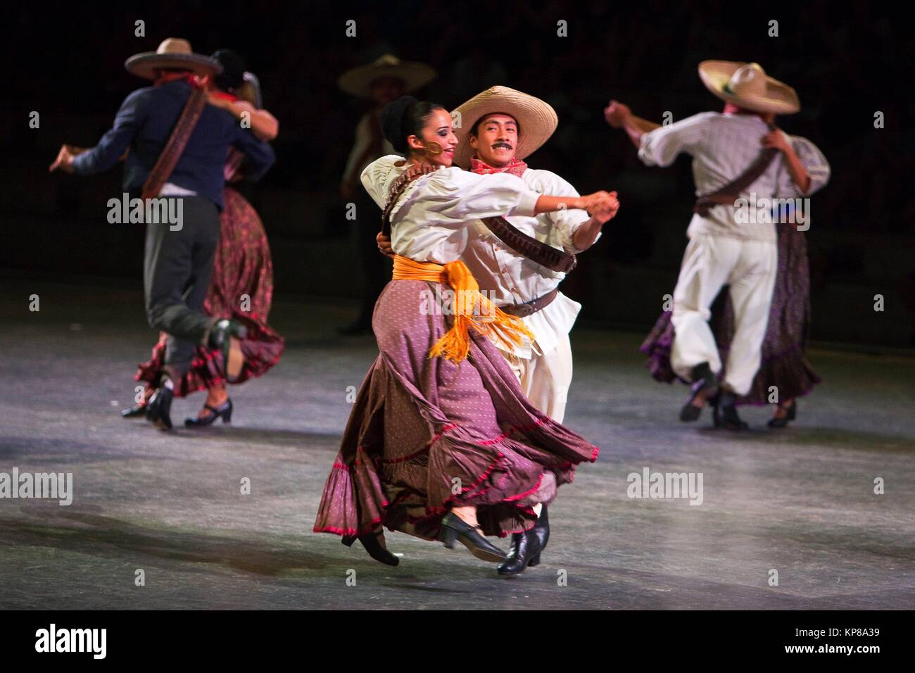Dancers during a performance of ´Mexico Espectacular´with traditional dress at the stage, Xcaret, Playa - Stock Image
