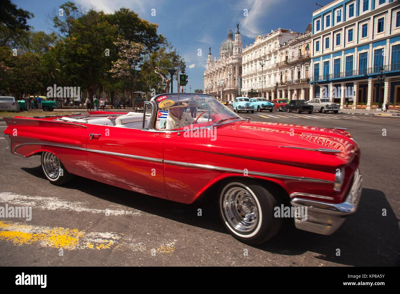 Vintage American car used as taxi in Central Havana with Hotel Telegrafo, Hotel Inglaterra, Gran Teatro and Capitolio - Stock Image