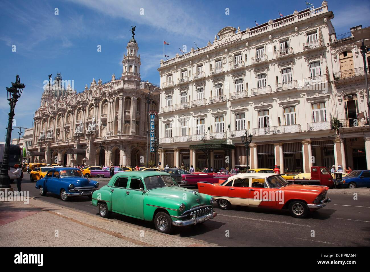 Vintage American car used as taxi in Central Havana with the Hotel Inglaterra, Gran Teatro and Capitolio building - Stock Image