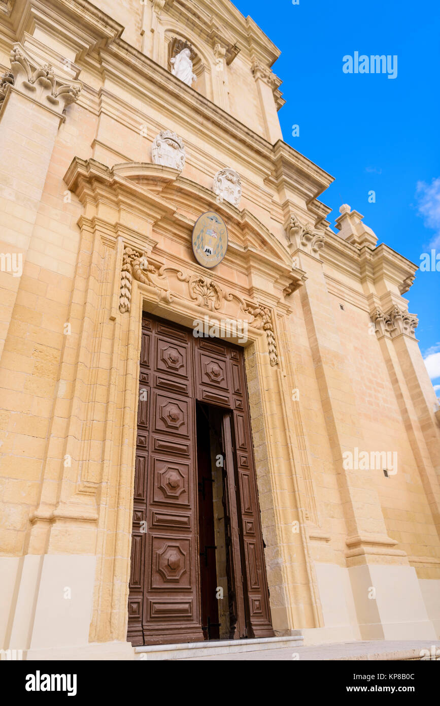 Wooden door entrance to the Citadella Citadel Cathedral, Victoria, Gozo, Malta. - Stock Image