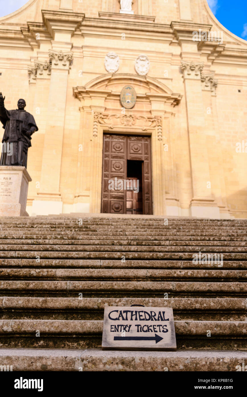 Sign pointing to the ticket booth on steps outside the entrance to the Citadella Citadel Cathedral, Victoria, Gozo, - Stock Image