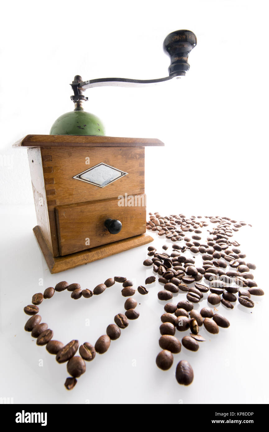 coffee mill with heart from coffee beans - Stock Image