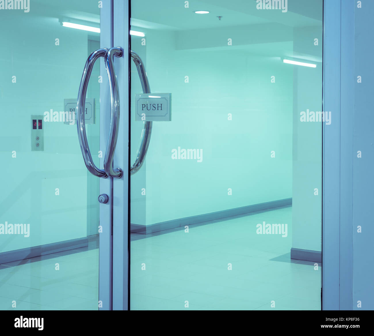 Glass door with chrome handles - Stock Image