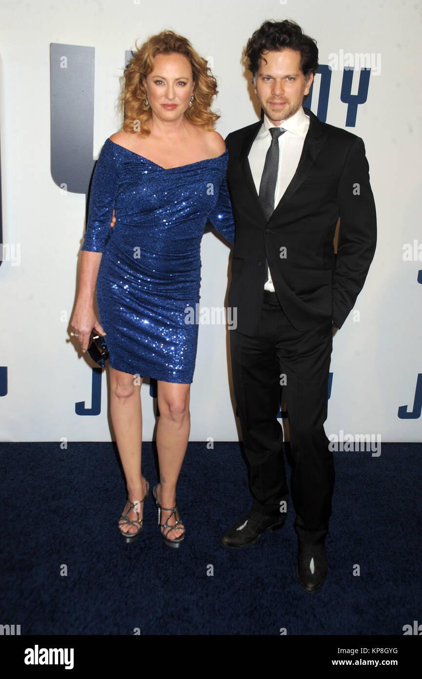 NEW YORK, NY - DECEMBER 13: Virginia Madsen,  Jack Sabato attends the premiere of 'Joy' at Ziegfeld Theater on December Stock Photo
