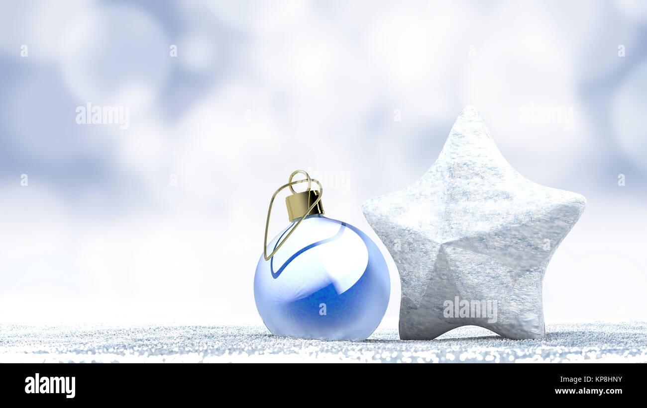 Christmas ornament ball and star on a fresh snow - Stock Image