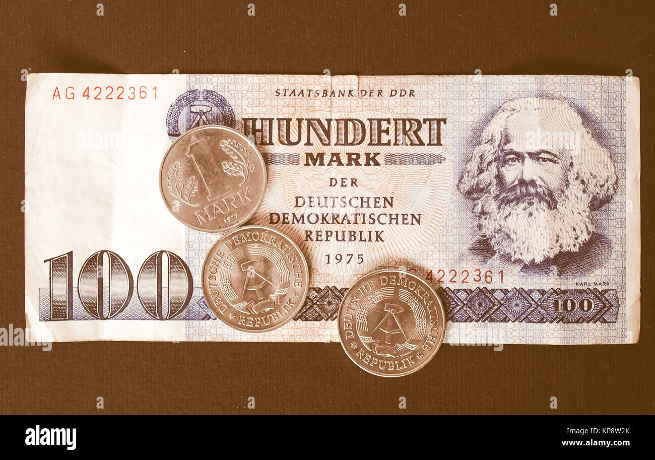 100 Mark banknote from the DDR (East Germany) with Karl Marx with 1 Mark coin - Note:  no more in use since german - Stock Image