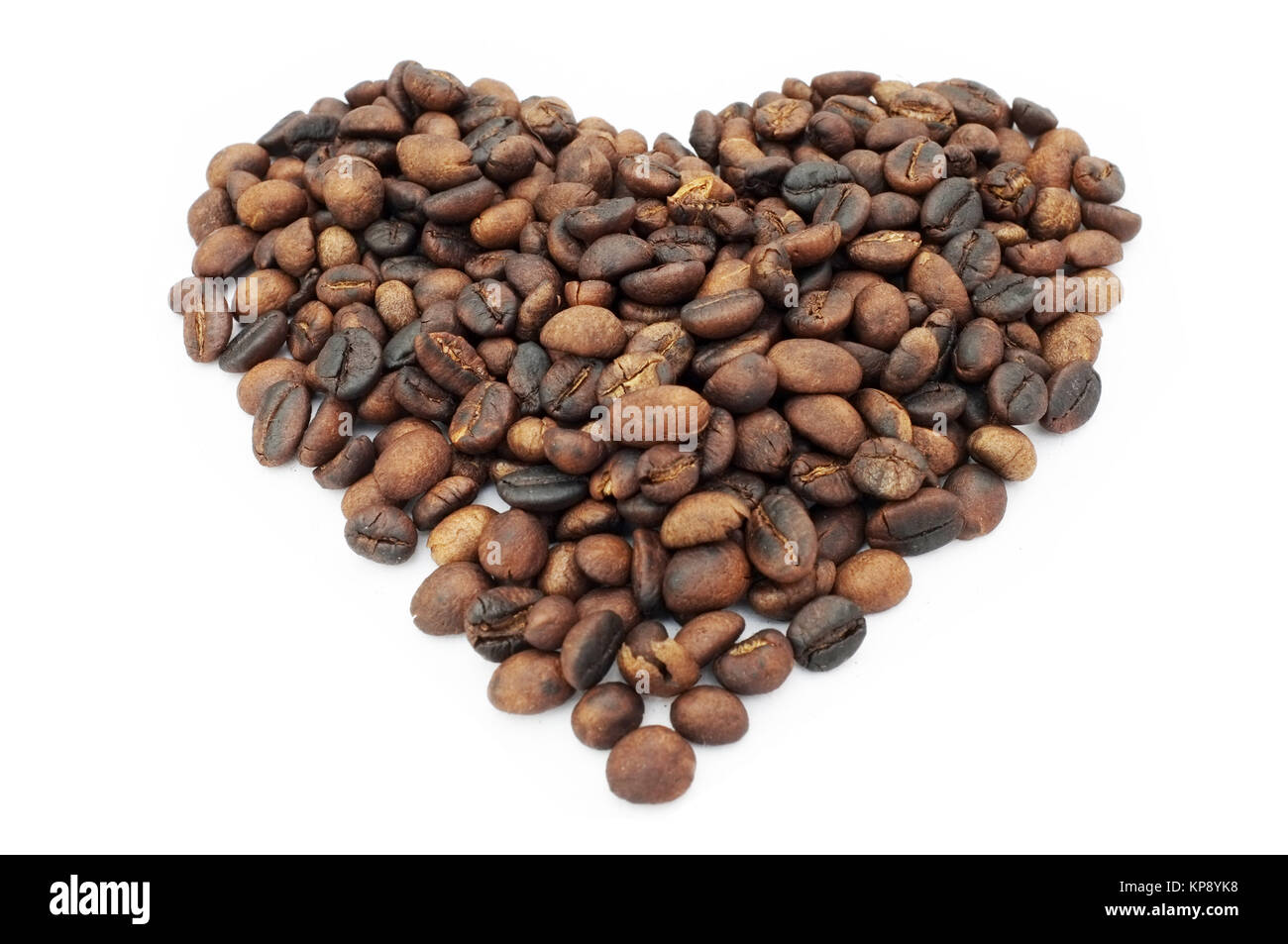 Heart shape coffee beans on white background Stock Photo