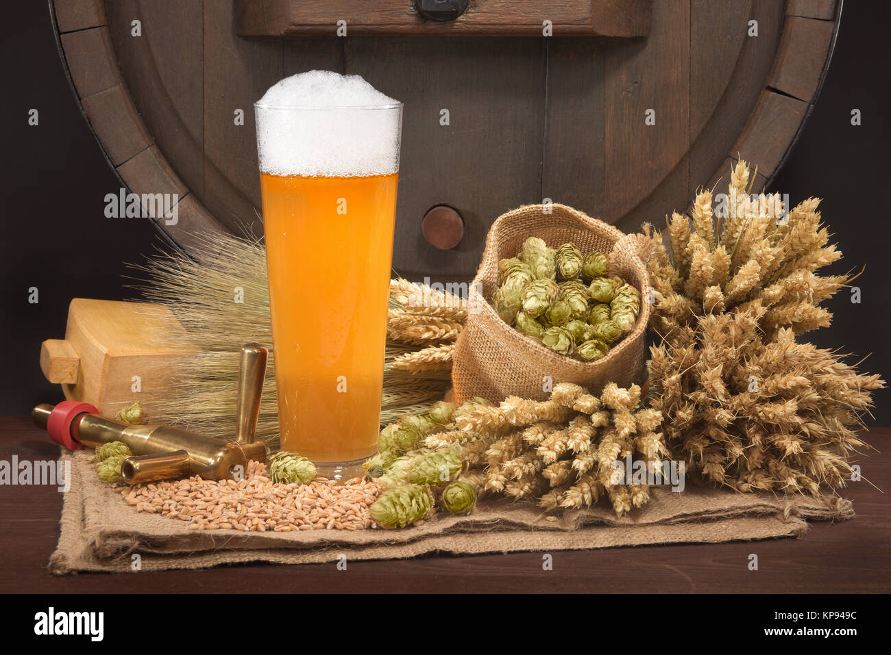 beer glass with the barrel - Stock Image