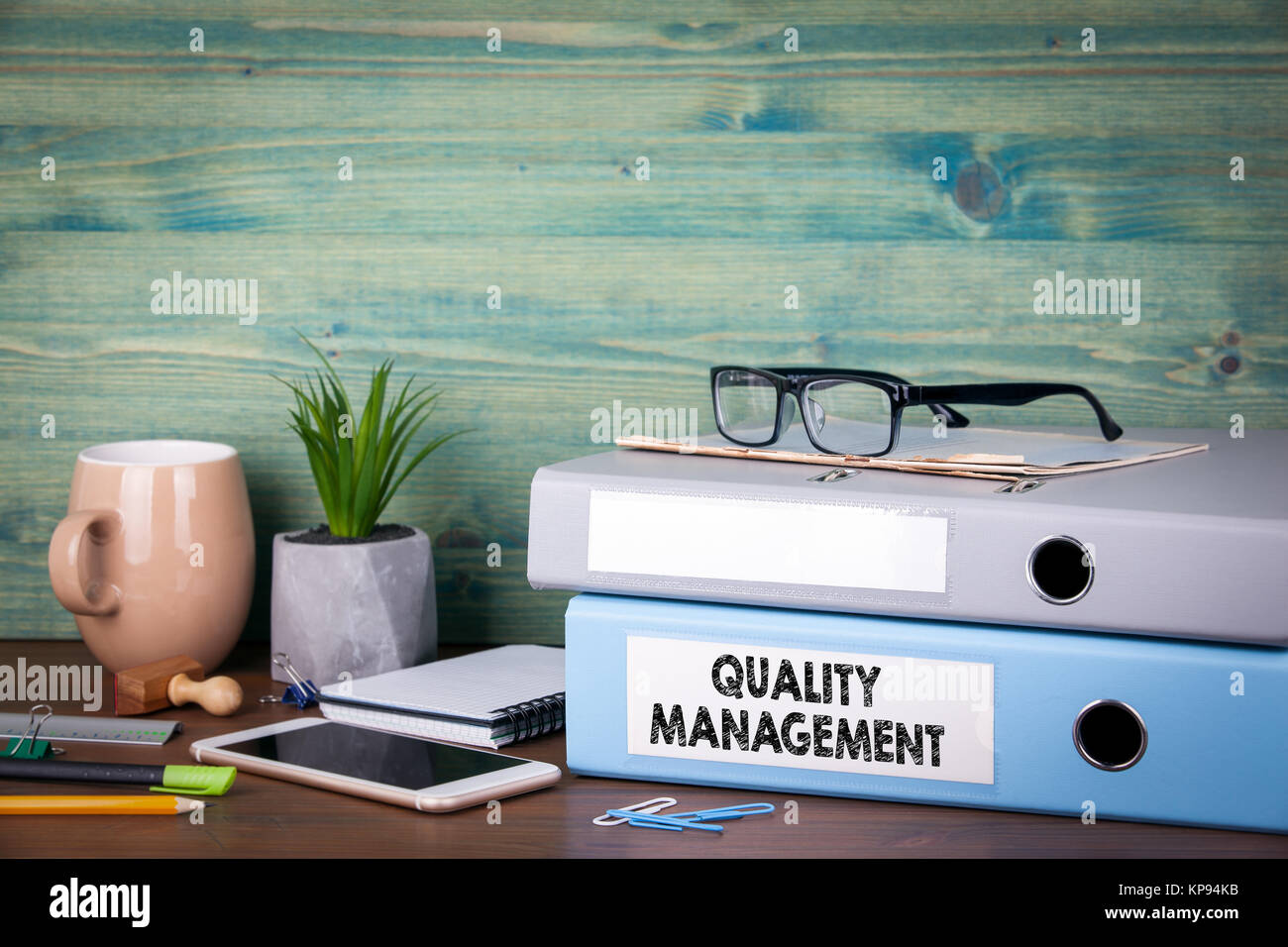 quality management concept. Binders on desk in the office. Business background - Stock Image