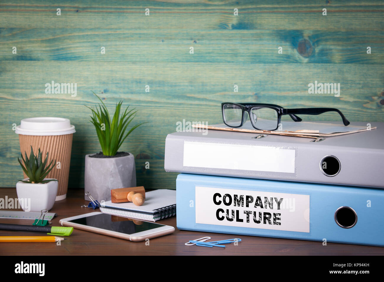 Company Culture. Binders on desk in the office. Business background - Stock Image