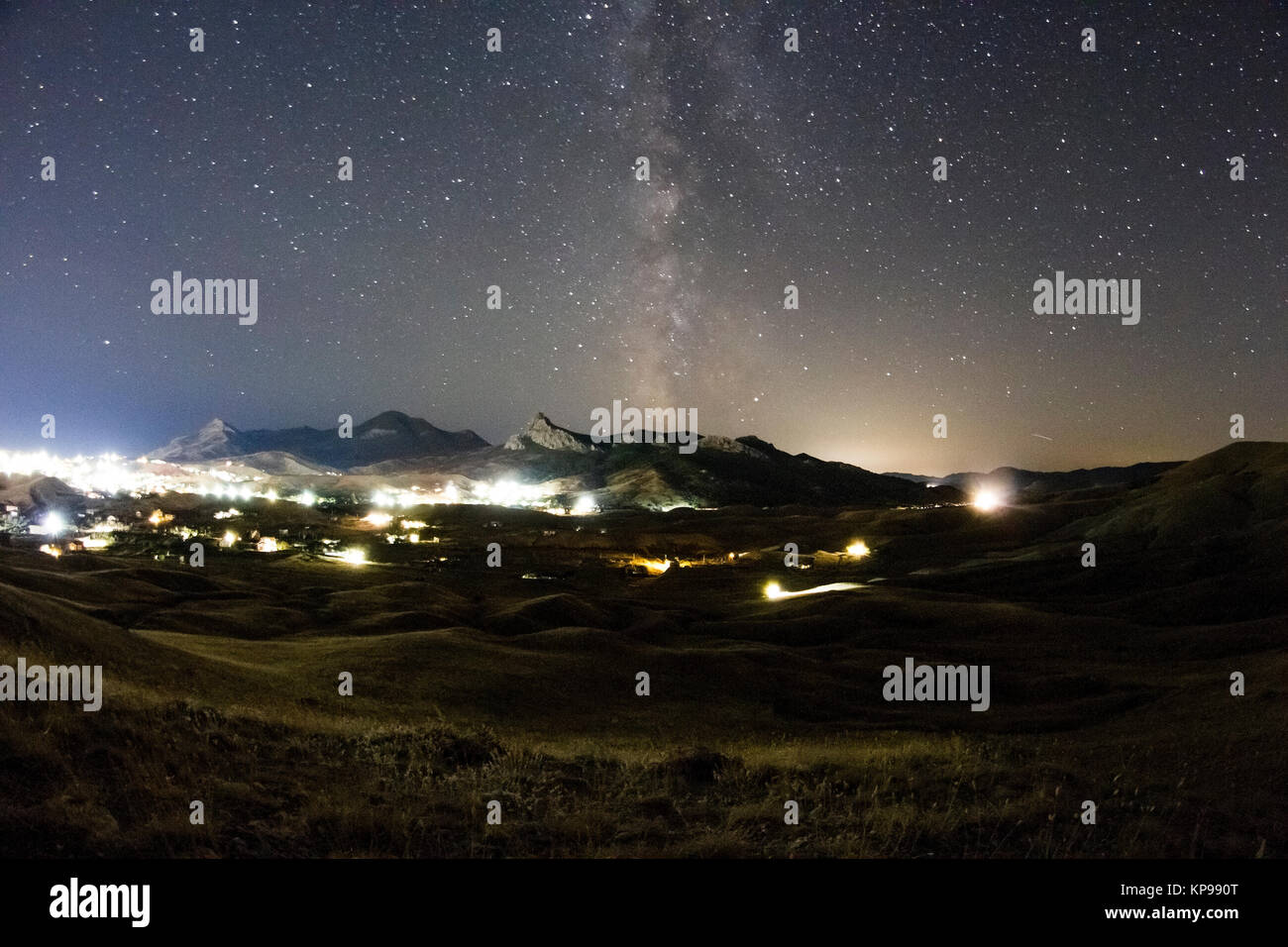 milky way over the mountain valley - Stock Image