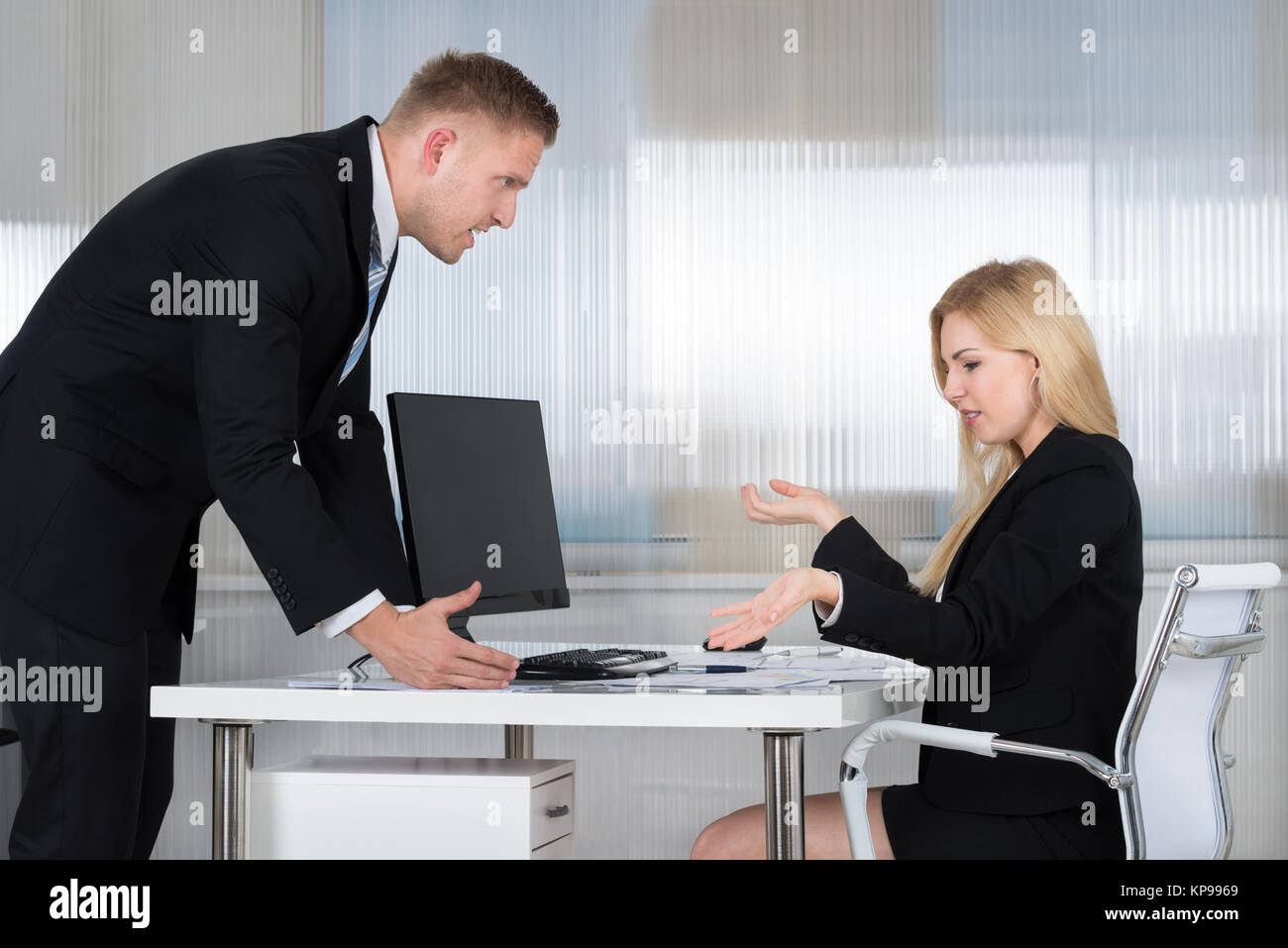 Businessman Blaming Employee In Office - Stock Image