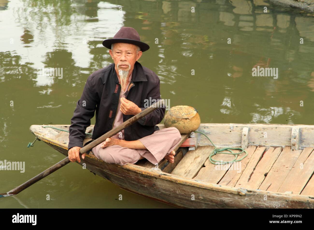 Hoi An boatman showing of his goatee near the Japanese bridge - Stock Image