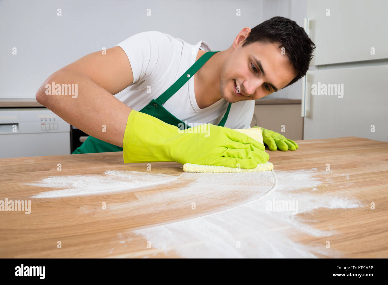 Cleaner Cleaning Dust On Wooden Table - Stock Image