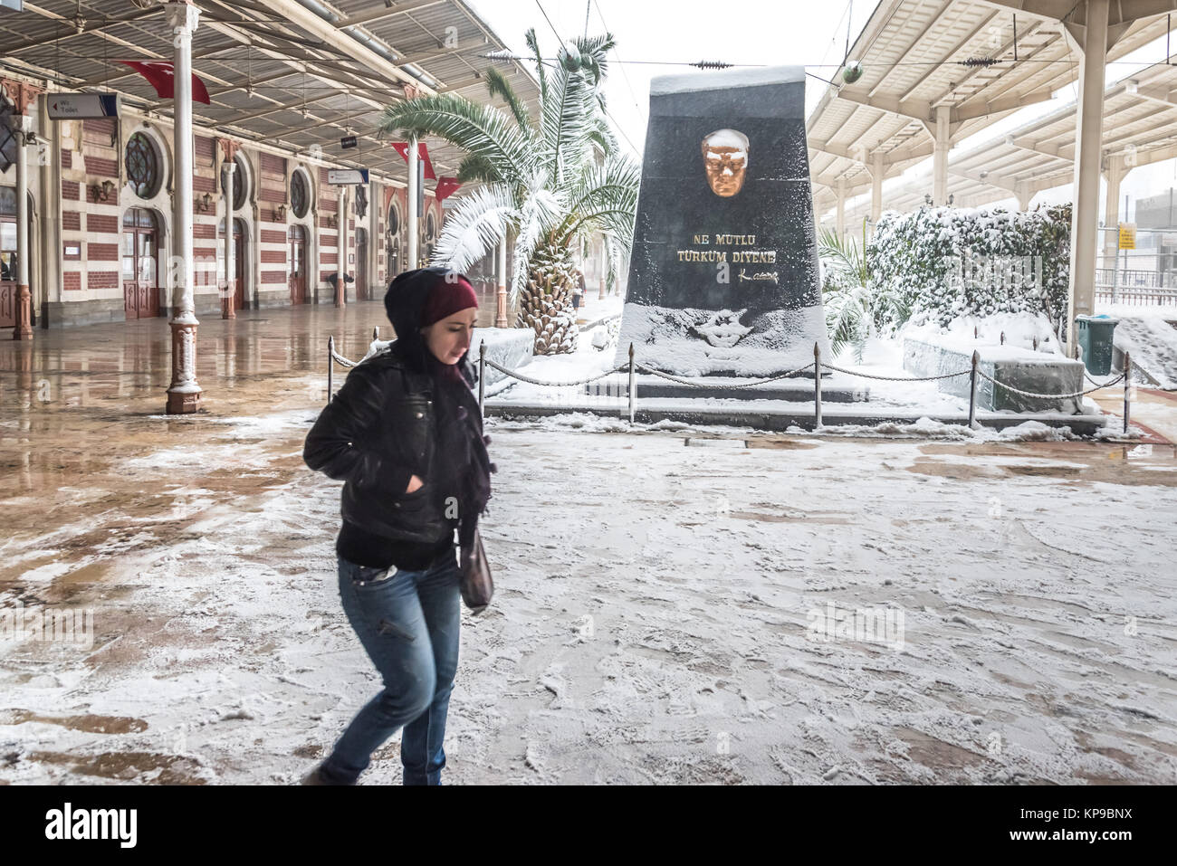 Unidentified woman walking at Sirkeci Train Station on a snowy day.Istanbul,Turkey .07 January 2017 - Stock Image