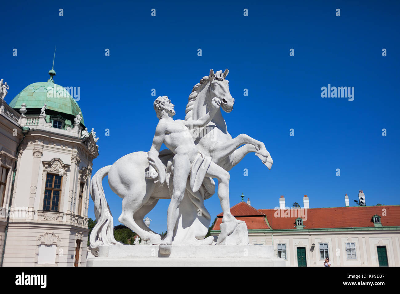 Man with a horse statue in front of Upper Belvedere in Vienna, Austria - Stock Image