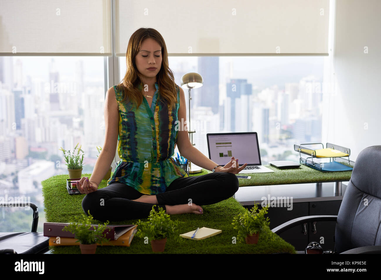 Business Woman Doing Yoga Meditation On Table In Office 2