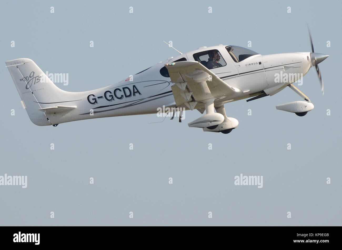 Cirrus SR20 private plane G-GCDA taking off from North Weald Airfield, Essex. Fixed undercarriage light plane. General - Stock Image