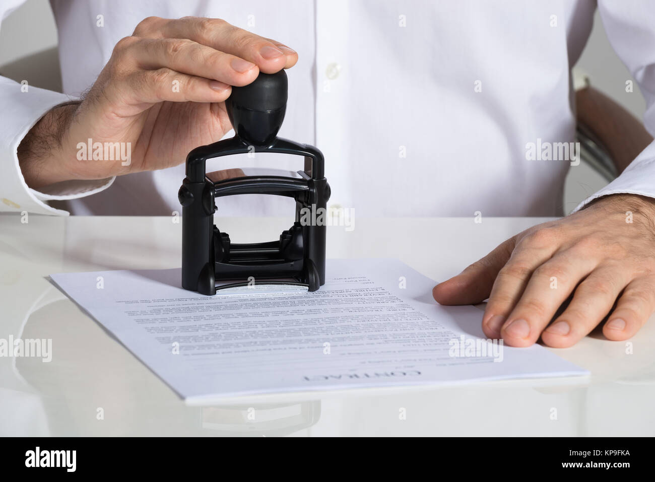 Businessman Stamping Contract Document - Stock Image