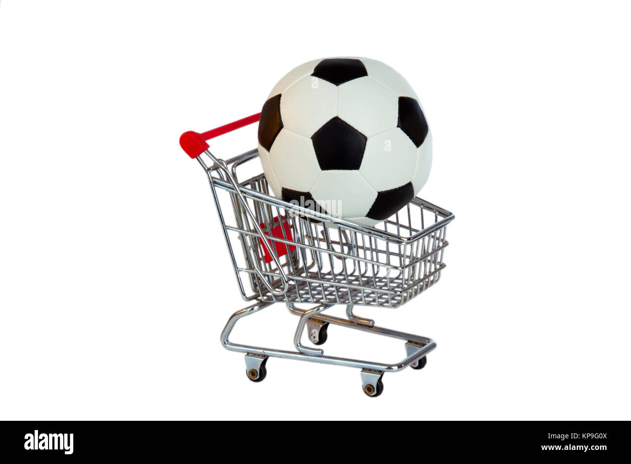 soccer in a shopping cart - Stock Image