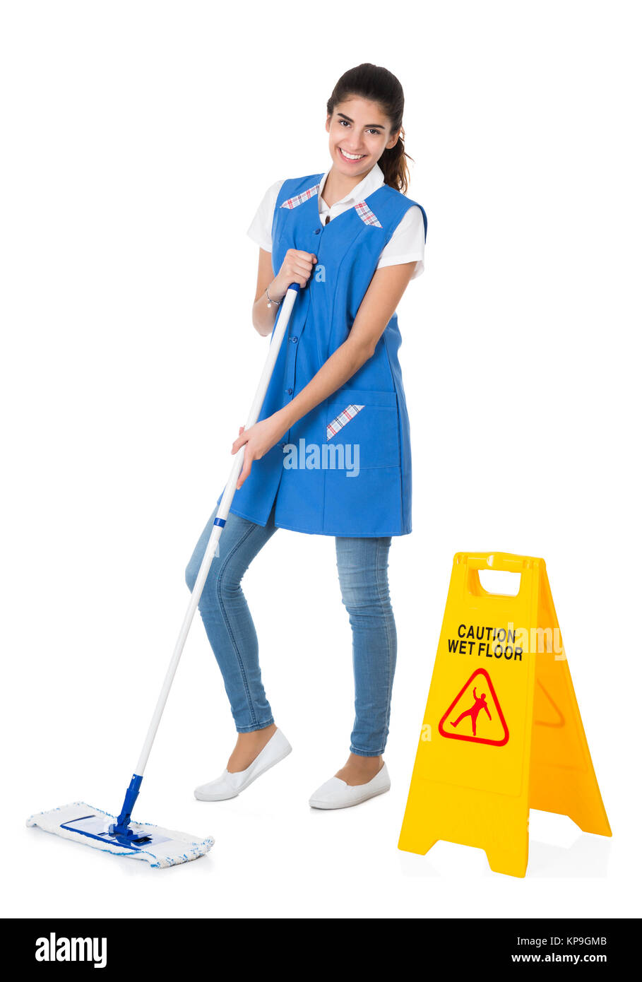 Happy Janitor Mopping By Caution Wet Floor Sign Stock Photo
