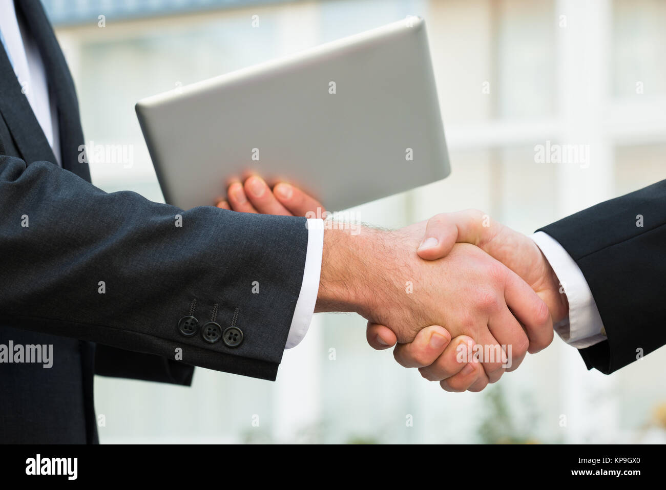 Businessman Shaking Hand With Partner - Stock Image