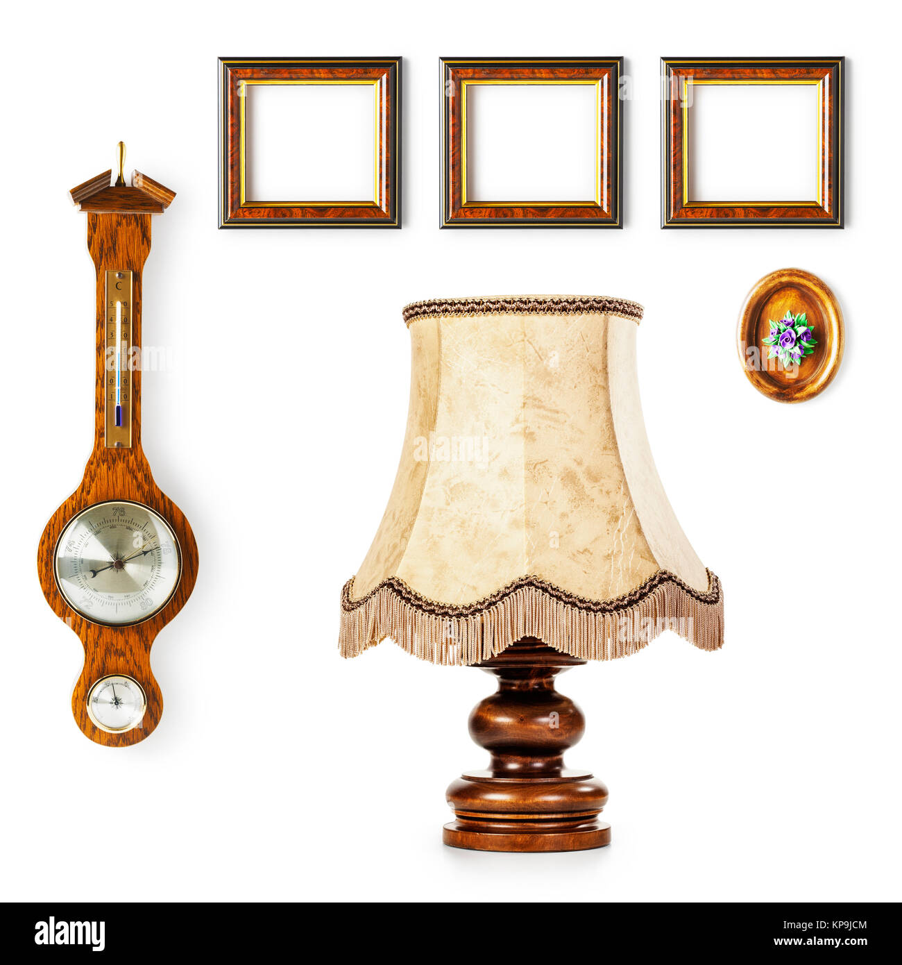 Vintage table lamp, barometer and small frames. Interior objects ...