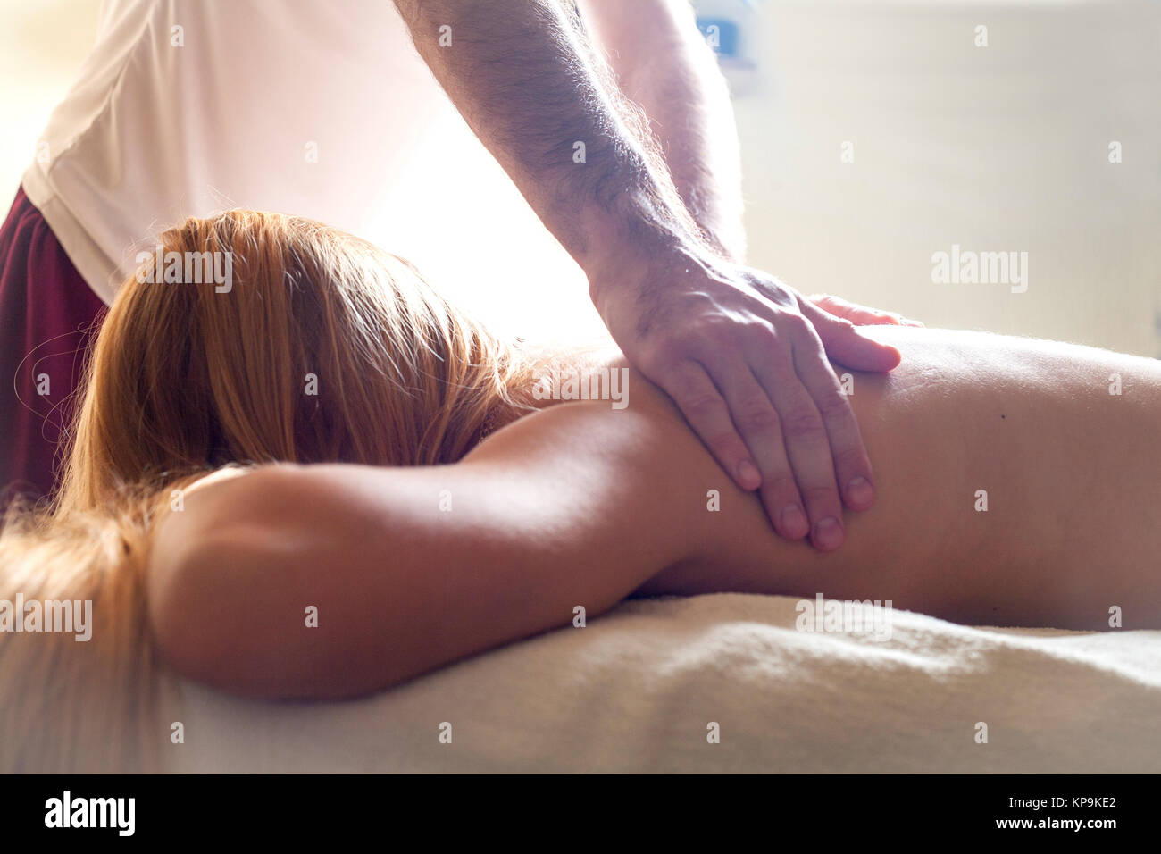 therapeutic massage manual therapy for curing pain in the joints of the osteochondrosis of the spine of muscle relaxation - Stock Image