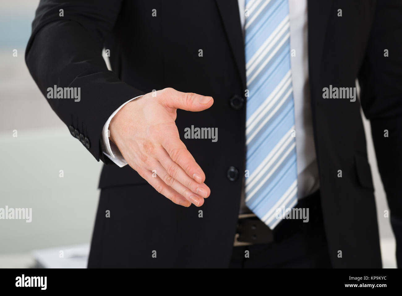 Businessman Offering Handshake In Office Stock Photo