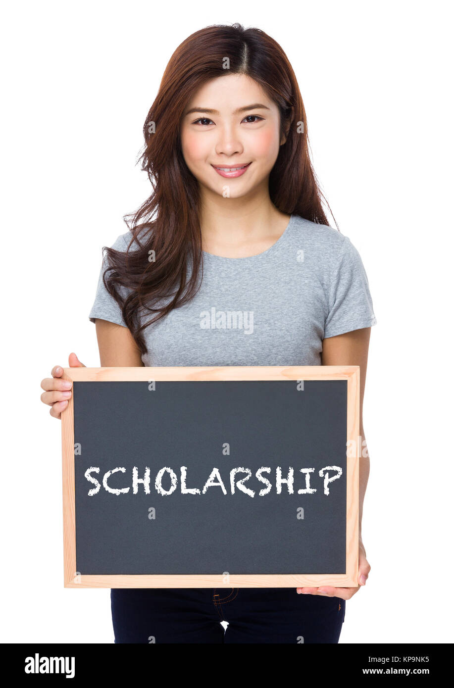 Young woman with chalkboard showing a word scholarship - Stock Image