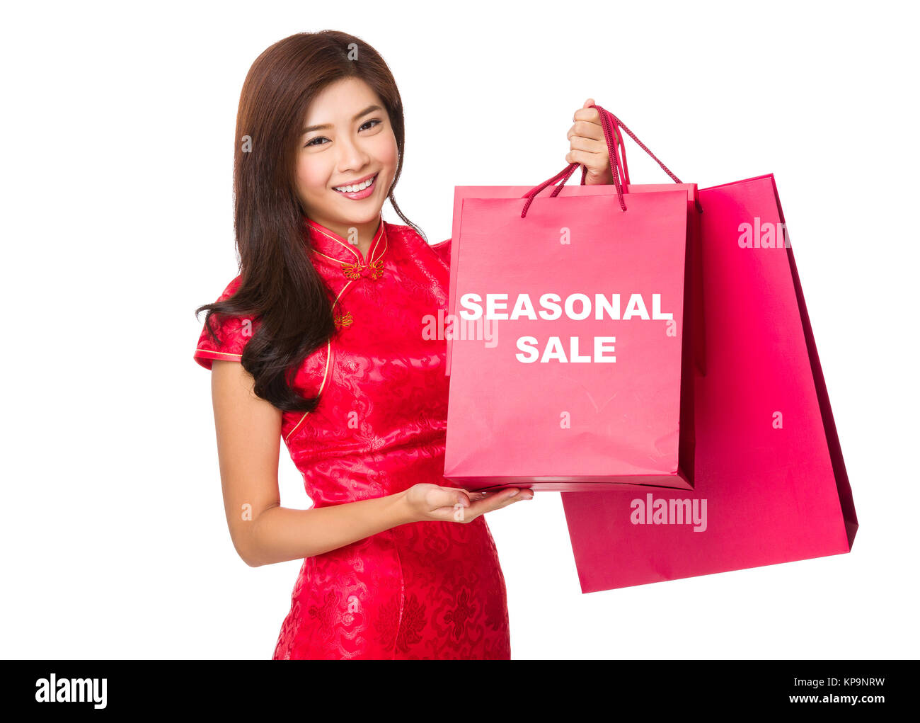 Chinese Woman hold with red paper bag and showing seasonal sale Stock Photo