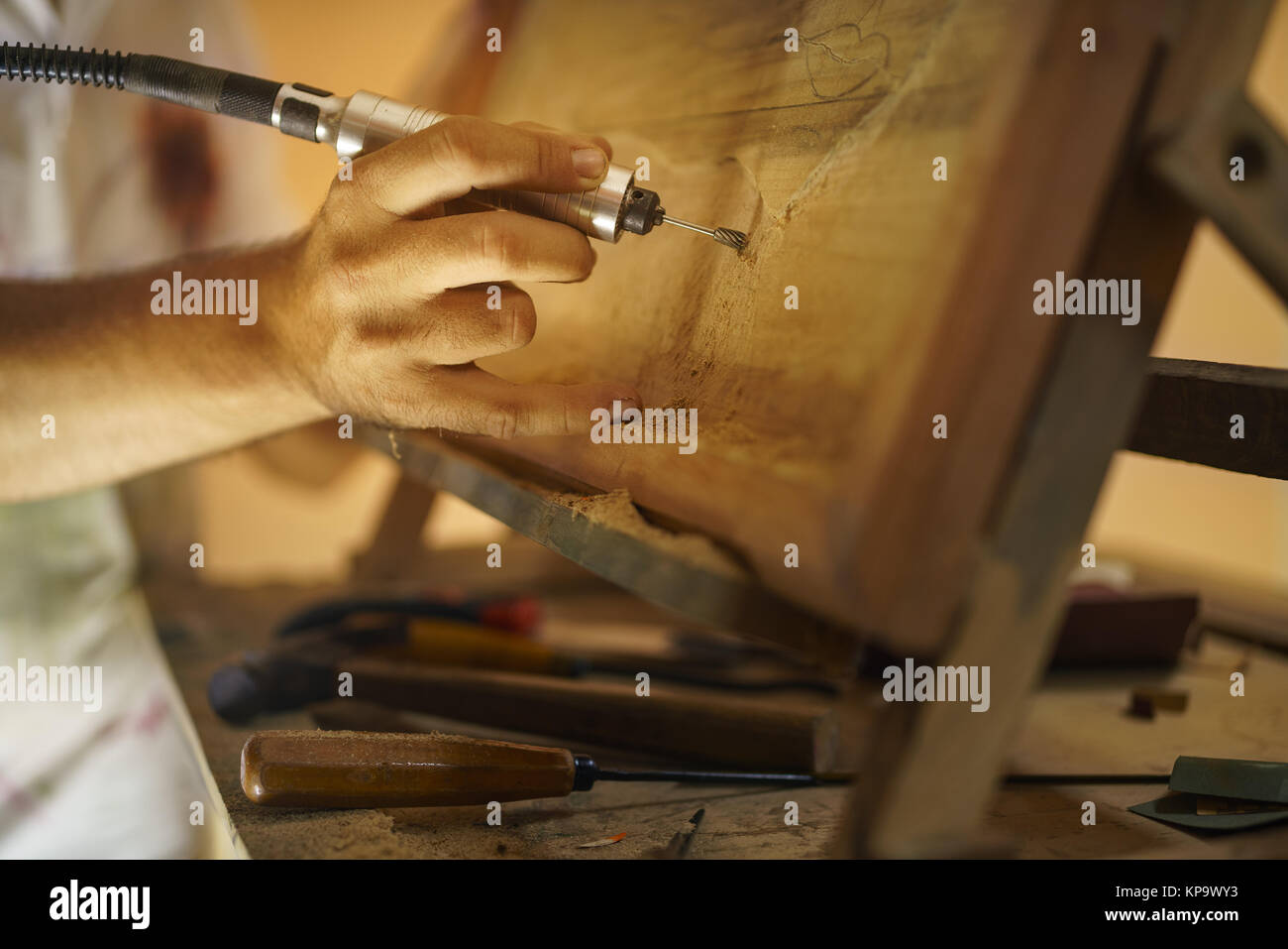 Sculptor Painter Artist Chiseling A Wooden Bas Relief-2 Stock Photo