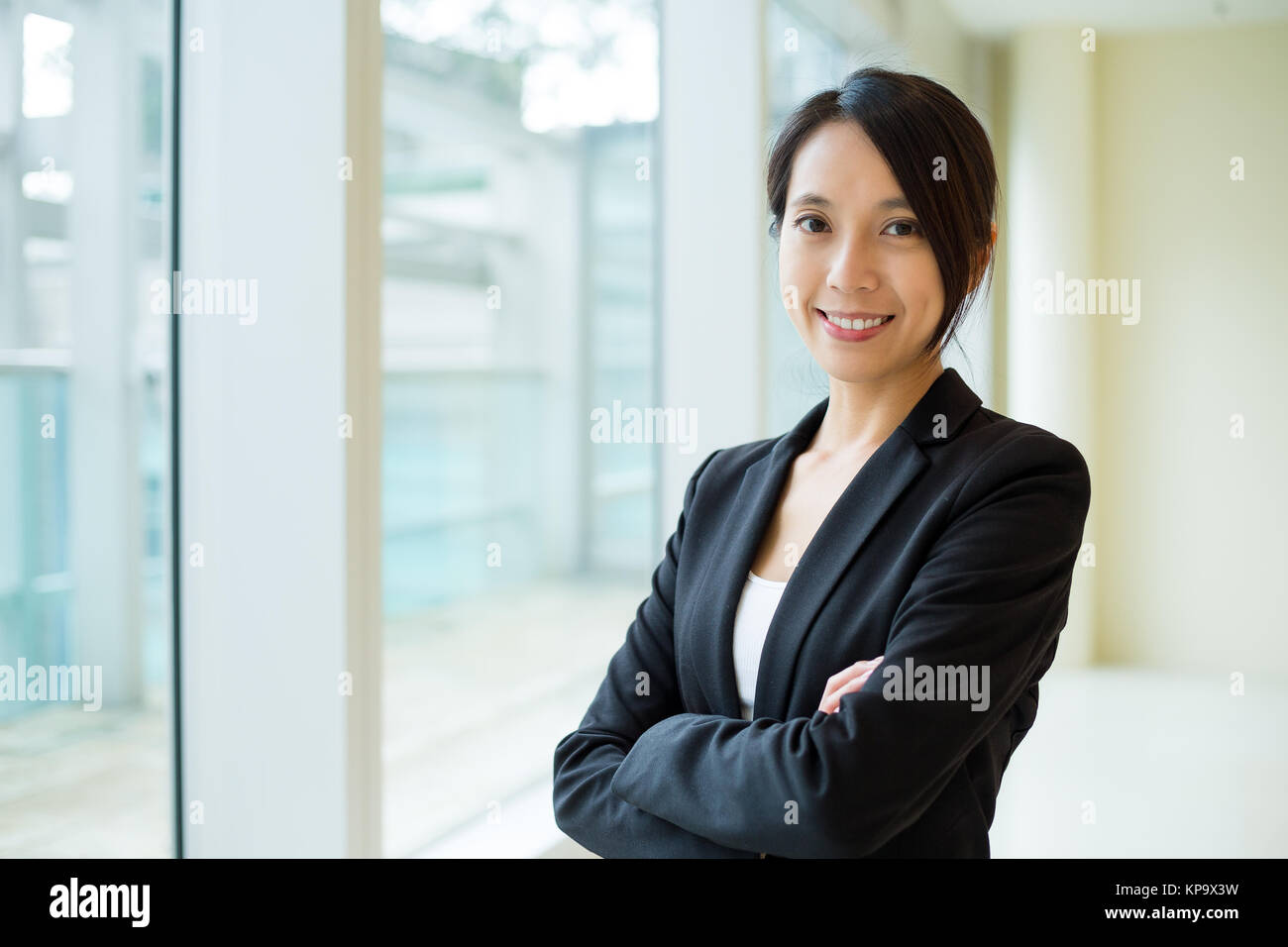 Businesswoman at office - Stock Image