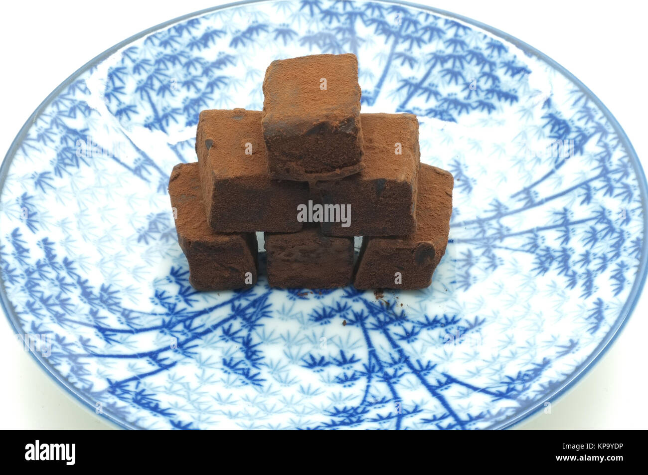Chocolate stacking on dish - Stock Image