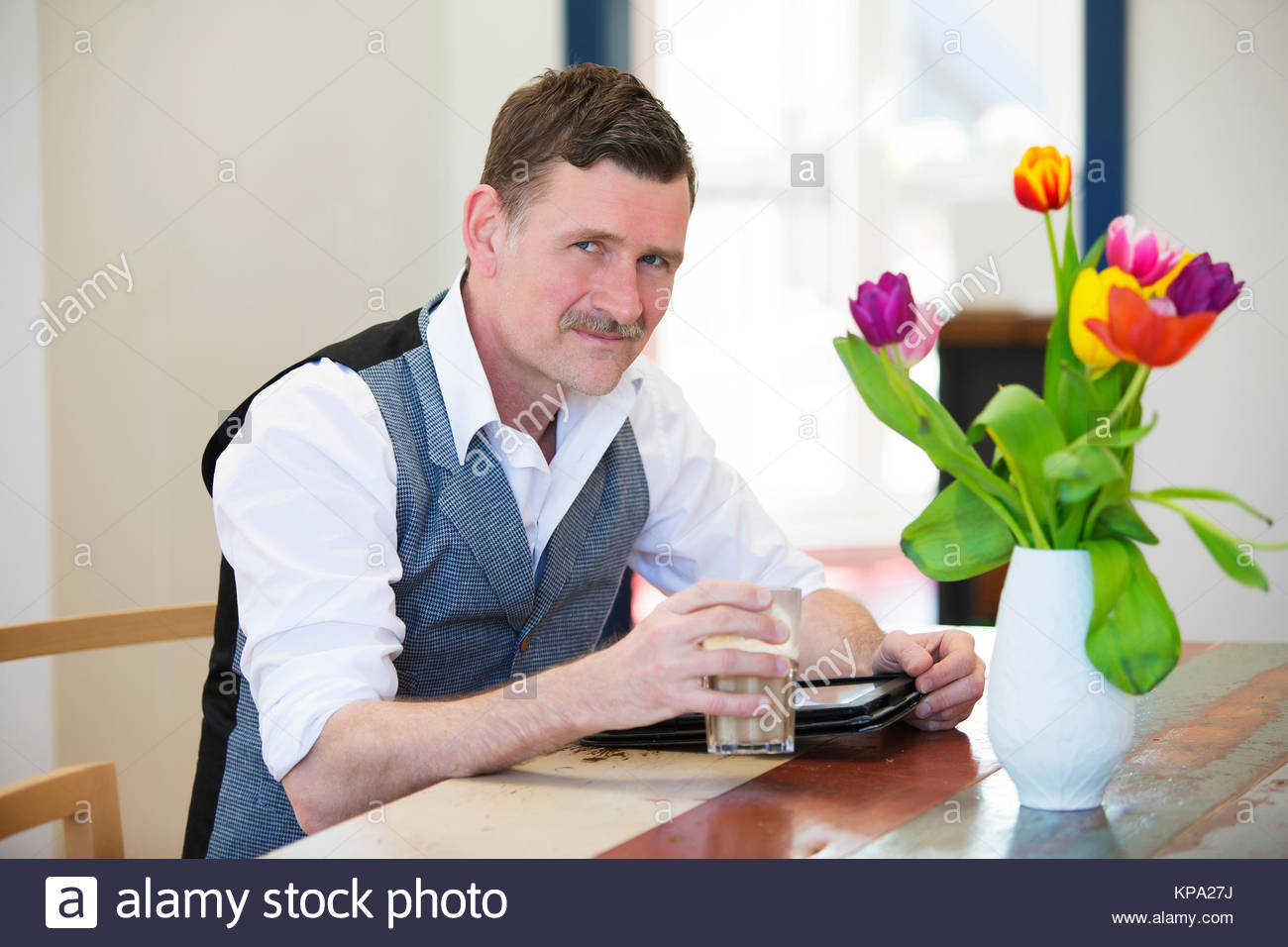 man with a coffee and a notepad - Stock Image