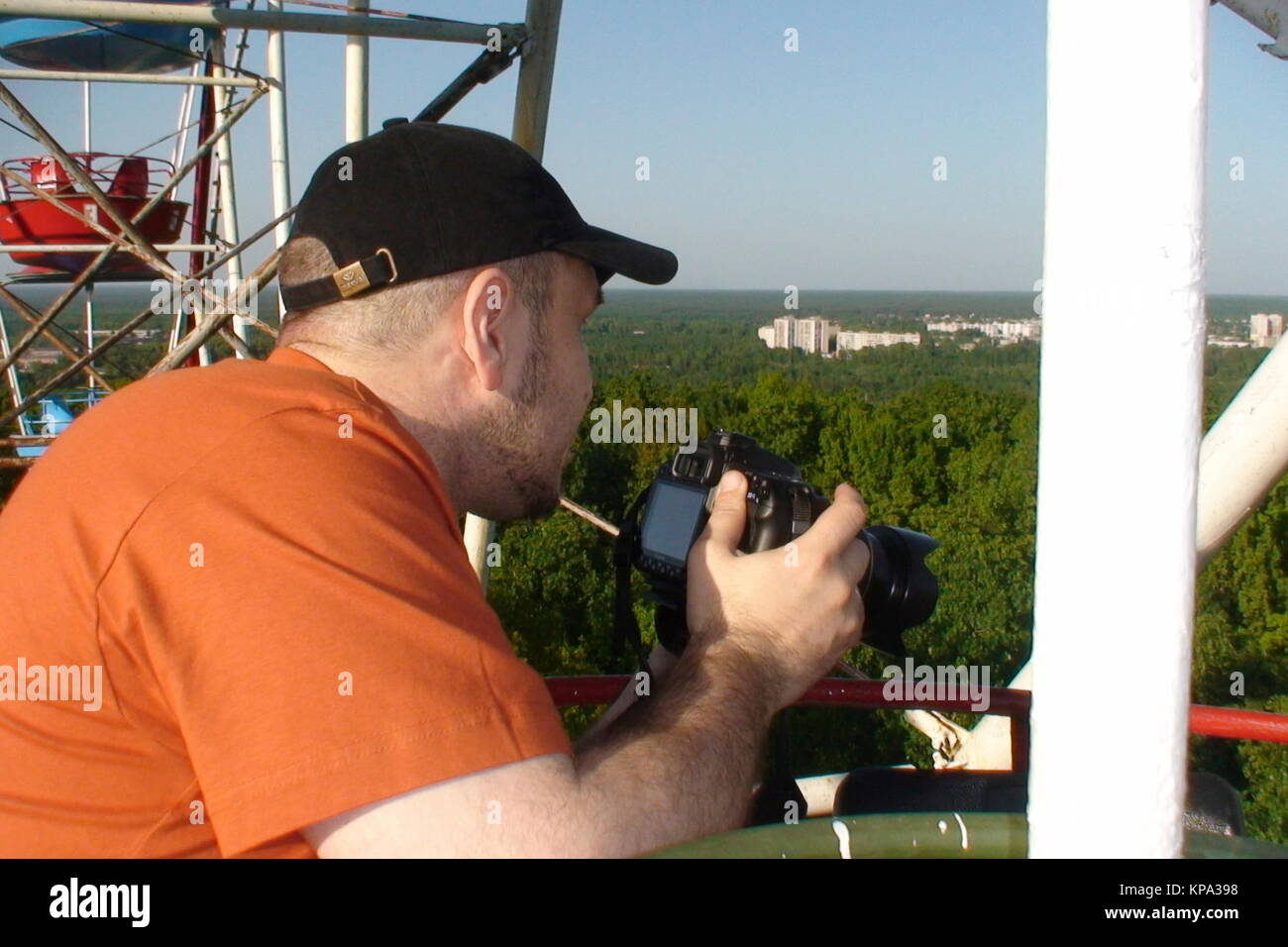 A man photographs the landscape from the height of the Ferris wheel. - Stock Image