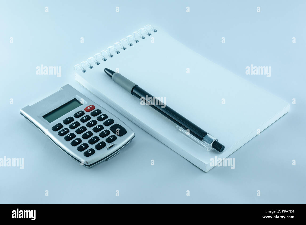 calculator, notepad and pen for your job - Stock Image