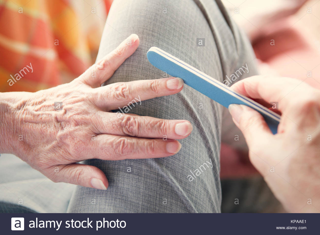 closeup of woman's hand with nailfile - Stock Image