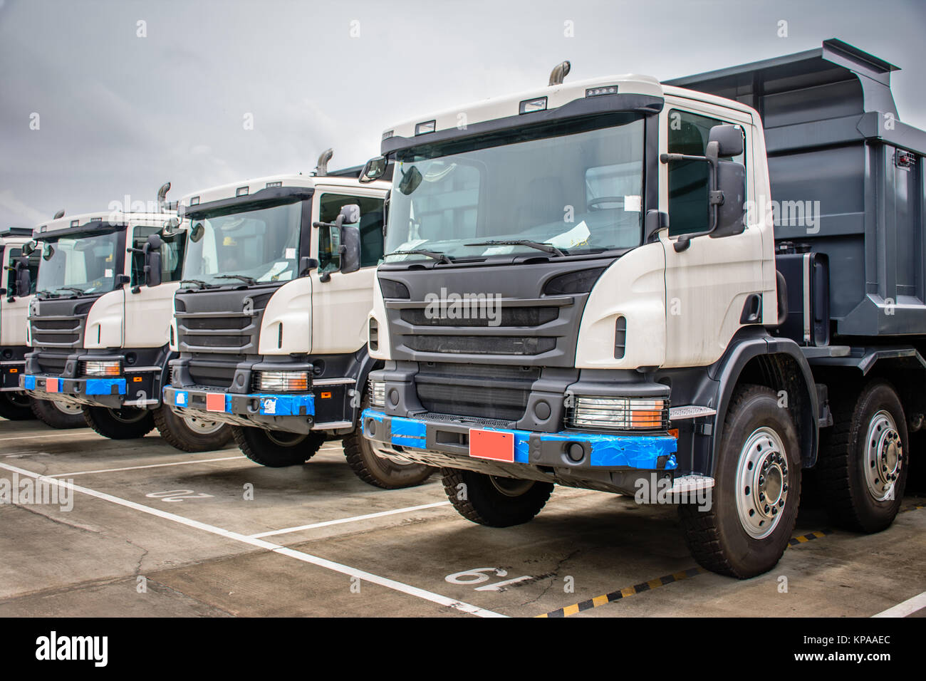 photo of brand new dump trucks, to use in construction site - Stock Image