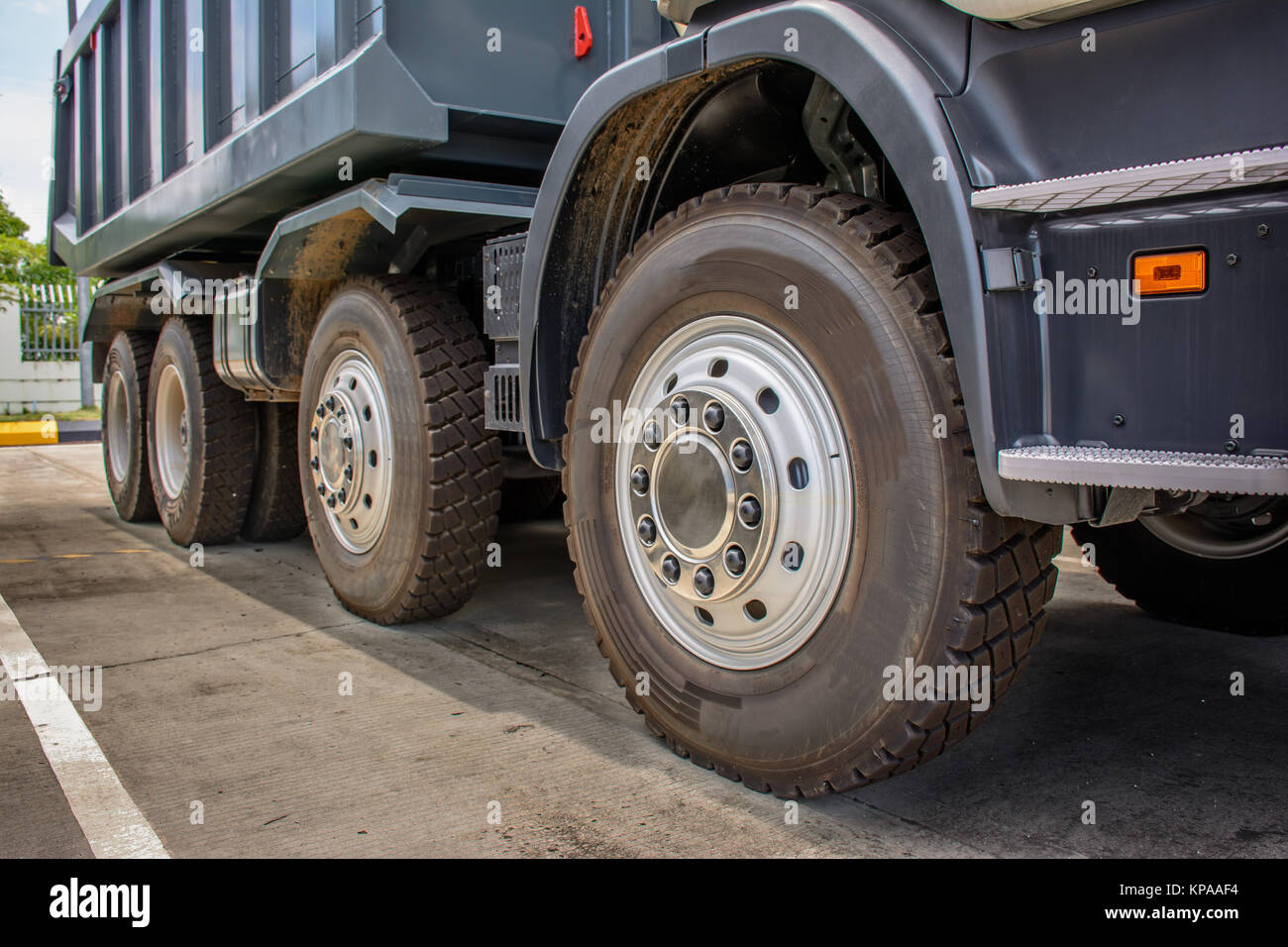 wheels of brand new dumb trucks - Stock Image