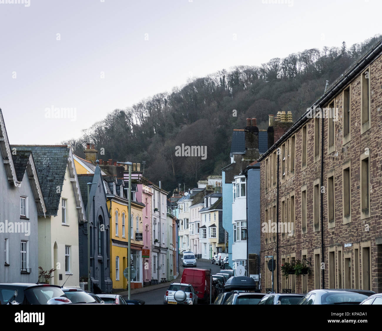 View along Higher Street, Dartmouth, Devon, with a wide variation of houses on each side. - Stock Image