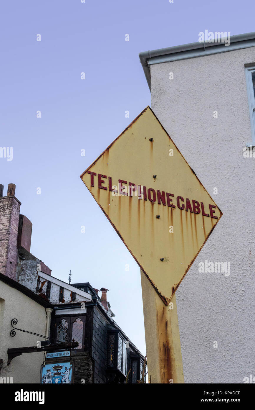 Sign marking the location of an underwater telephone cable at Dartmouth, England, UK. - Stock Image