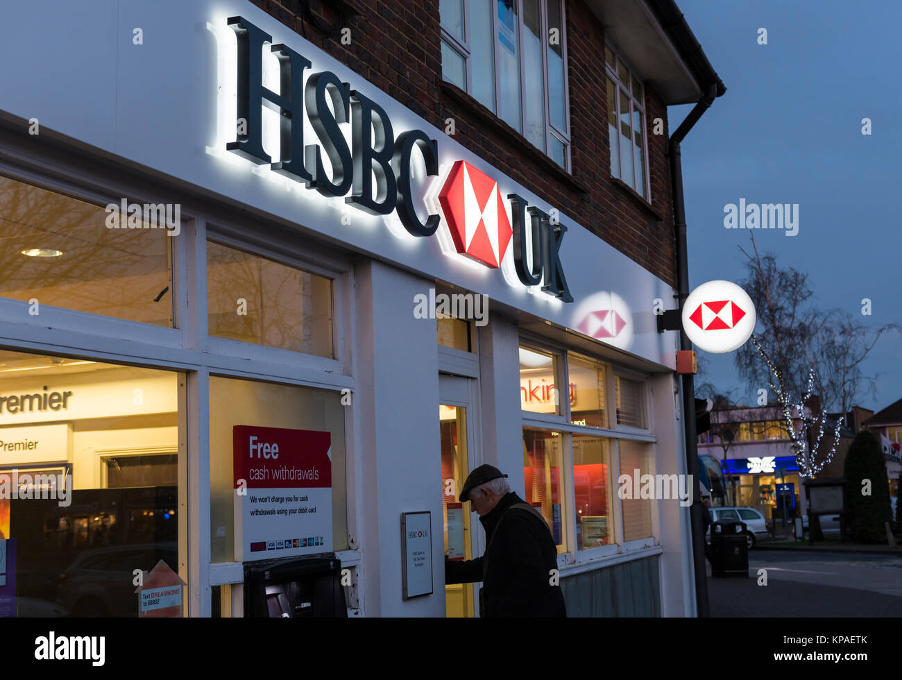 HSBC bank branch open into the evening in Winter in Rustington, West Sussex, England, UK. - Stock Image