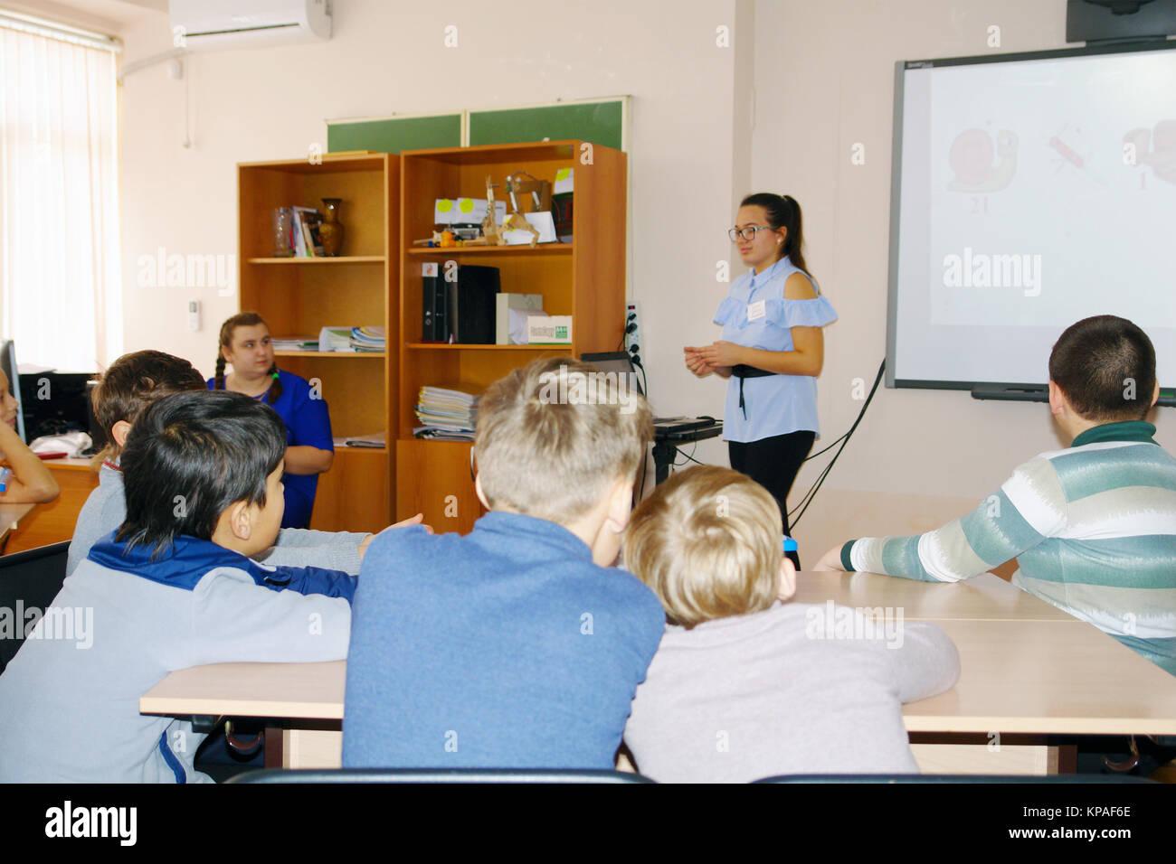 School kids in class with teacher woman - Stock Image