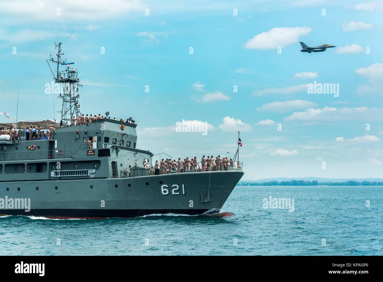 Pattaya, Thailand - November 9, 2017, Navy warships running on sea while warplane flying above warships on the 50th - Stock Image