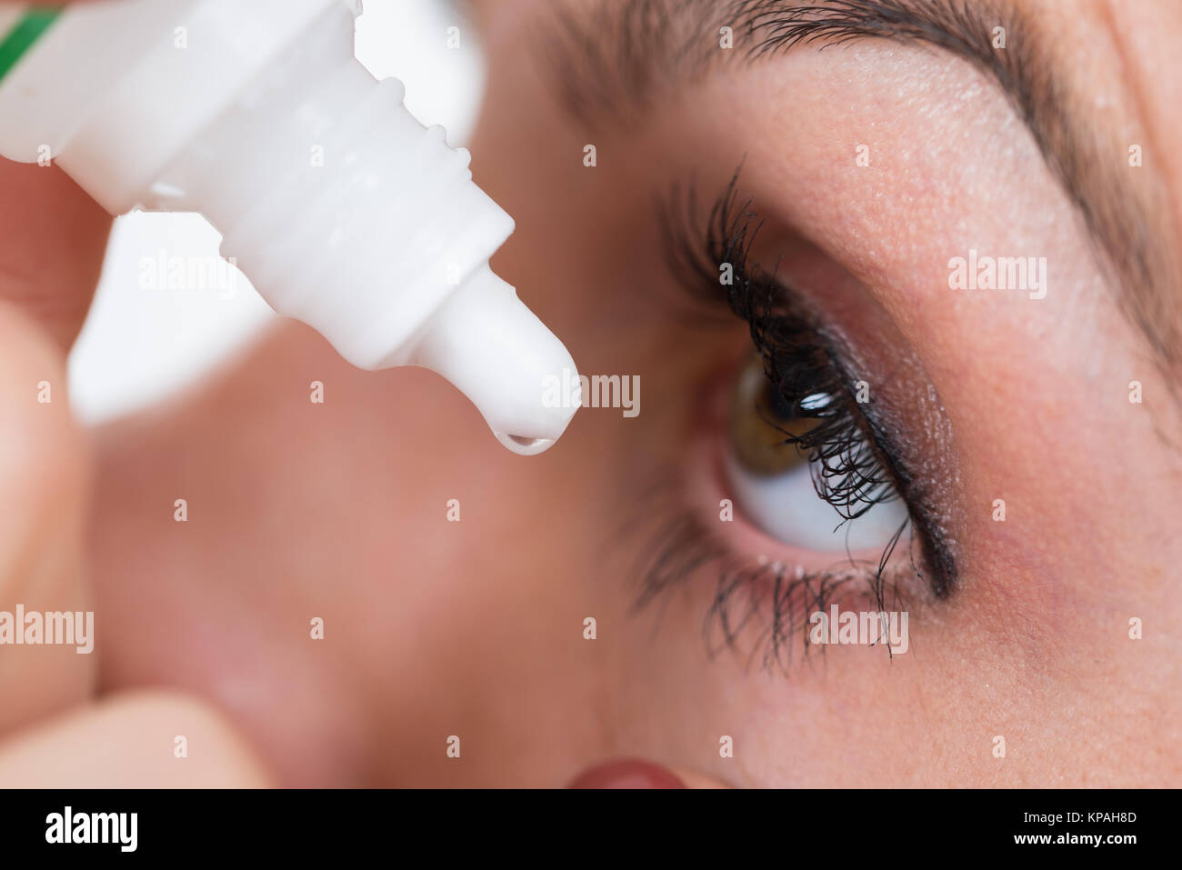 Close-up Of Person Pouring Drops In Eyes - Stock Image