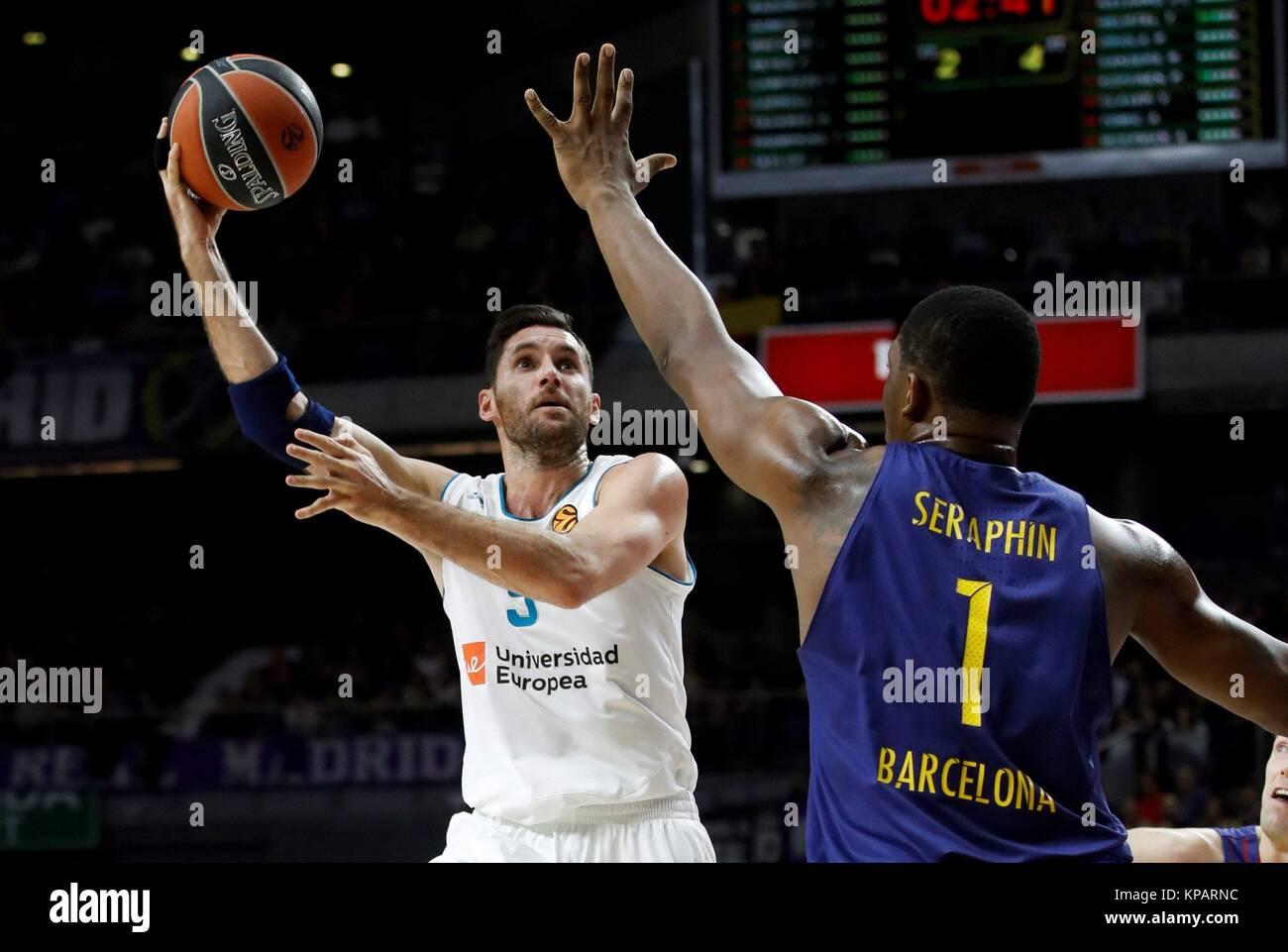 e28892468 Real Madrid s Rudy Fernandez (L) in action against FC Barcelona Lassa s  Kevin Seraphin during the Euroleague 12nd round match between Real Madrid  and FC ...