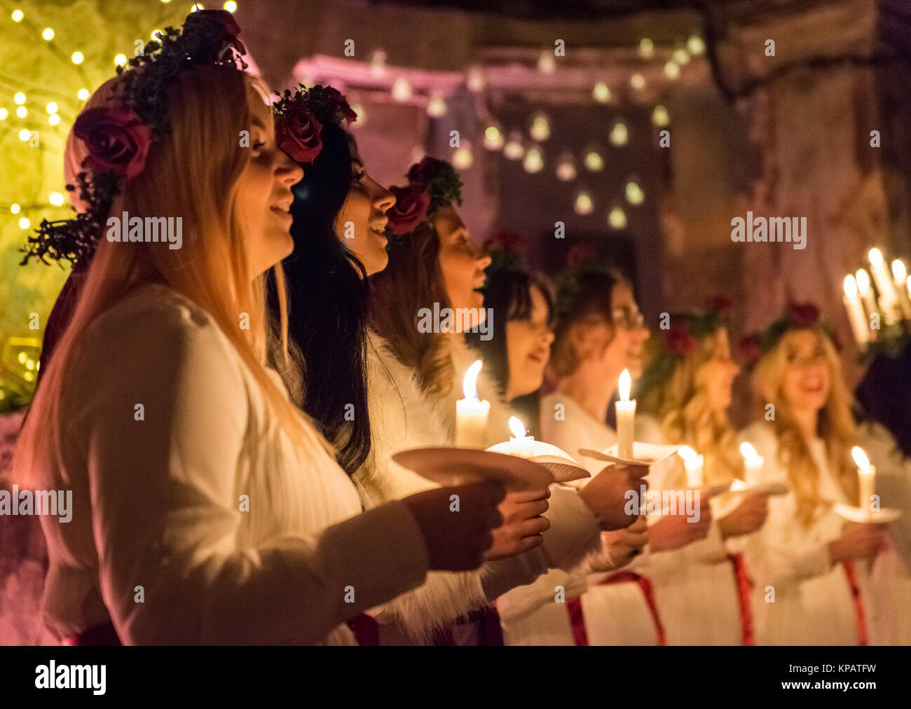 London, UK. 14th December, 2017. Swedish choir with candles and head wreaths celebrating the Scandinavian tradition - Stock Image